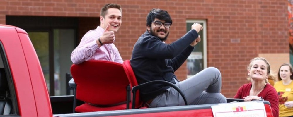 President Graber, Vice President Bhatia, Finance Director Mueller, and Director of Outreach Swartz at the Homecoming Parade